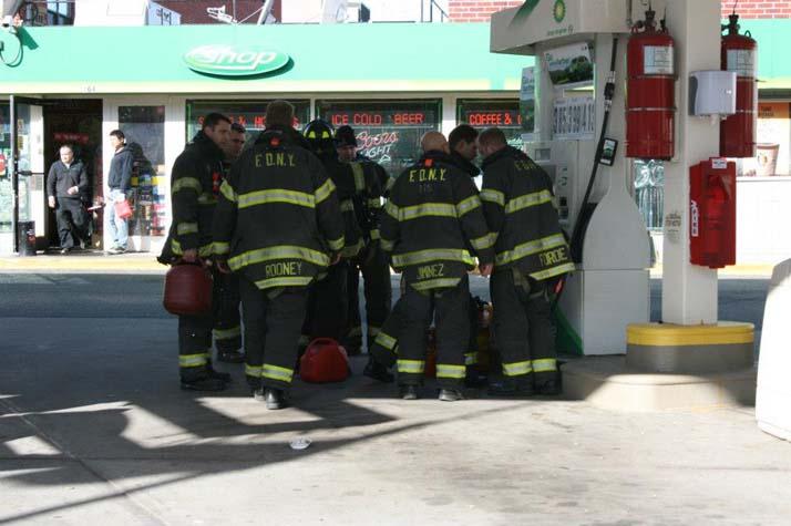 Firemen Gas Up, by Keren Sachs