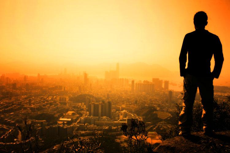 PlusONE |Man standing on the edge of Hong Kong's Lion Peak