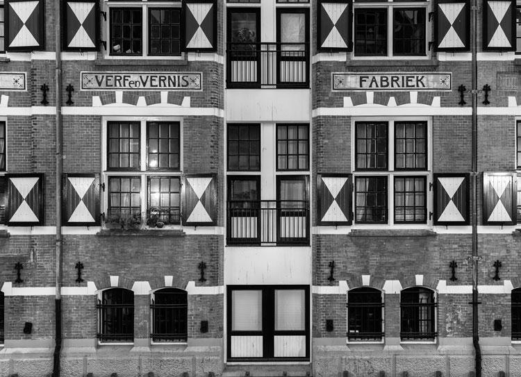 Rob van Esch |Exterior of quaint houses along a canal in Amsterdam