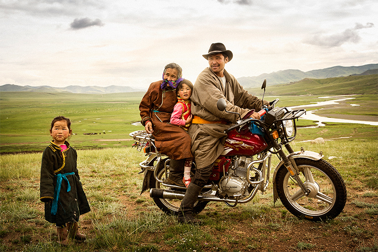 Brian Hodges| Mongolia, July 17, 2013: Mongolian family traveling by motorcycle