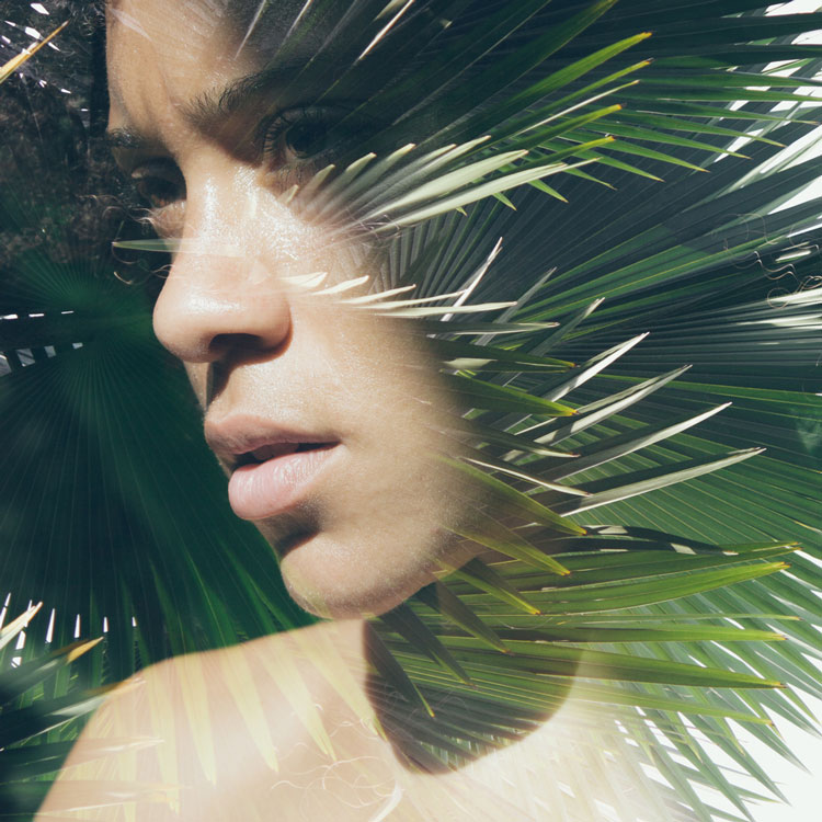 Double exposure photo of woman blended with palm tree | Victor Tongdee