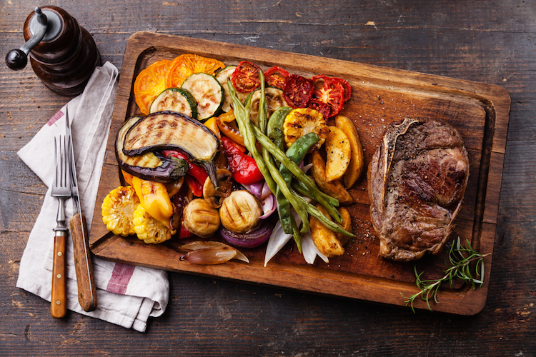 Club beef steak with pepper sauce and grilled vegetables byLisovskaya Natalia
