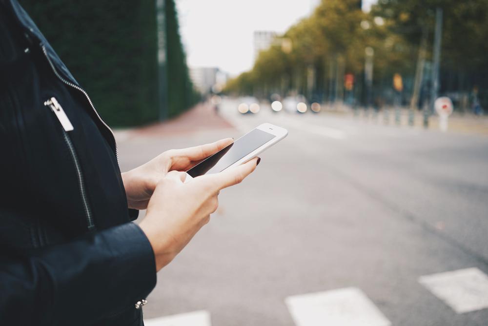 woman on phone sidewalk stock photo